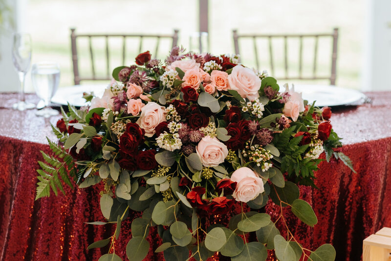 "alt=""burgundy floral arrangement"""