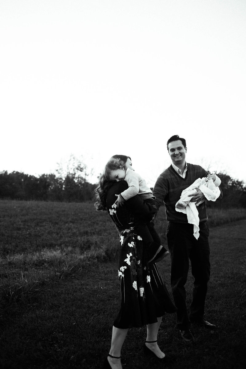 Family of four walking at sunset session, lifestyle family photographer Elle Baker PHotography