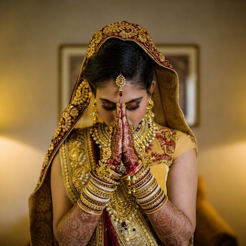 South Asian Bride saying  prayer