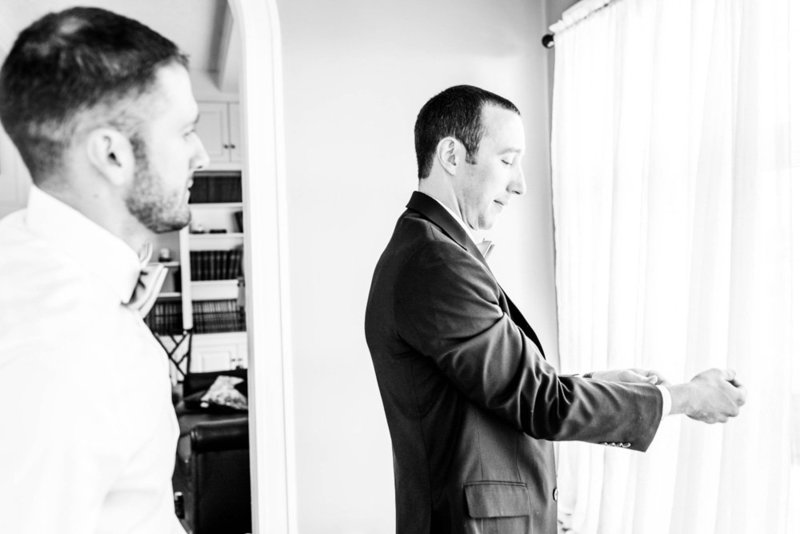 groom getting dressed at eastern shore wedding at kirkland manor by costola photography