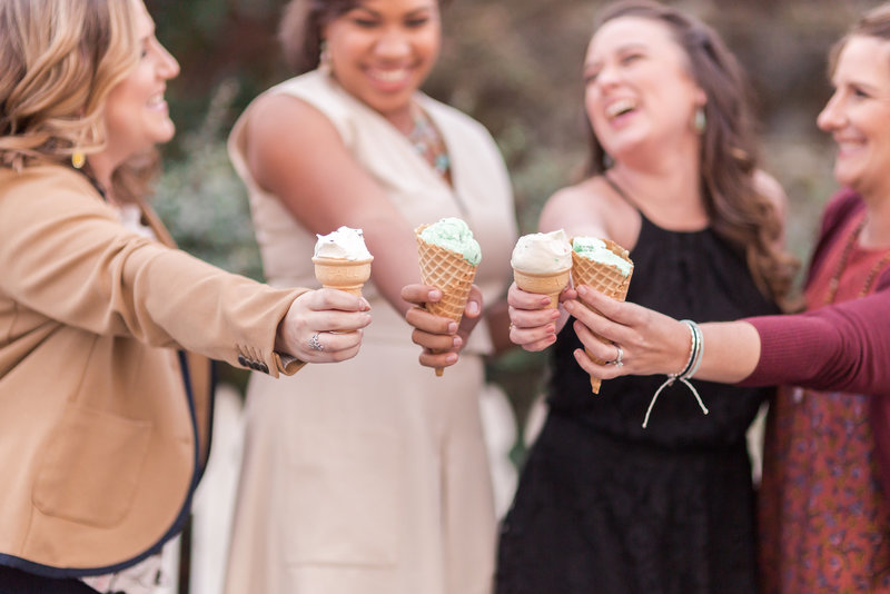 women laughing together with ice cream