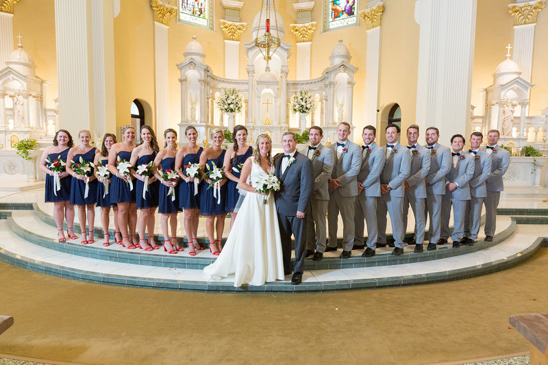 Bridal party standing in front of the altar at St. Patrick's Church wedding