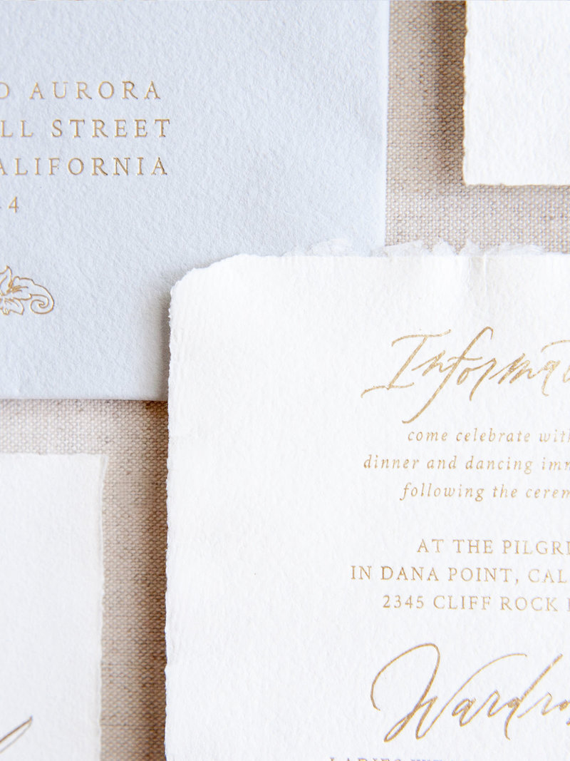 Semi-Custom Invitations - Romantic Chateau Collection Closeup of gold foil on handmade paper