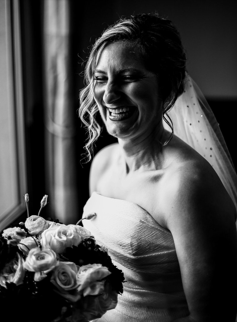 Solo portrait of bride laughing