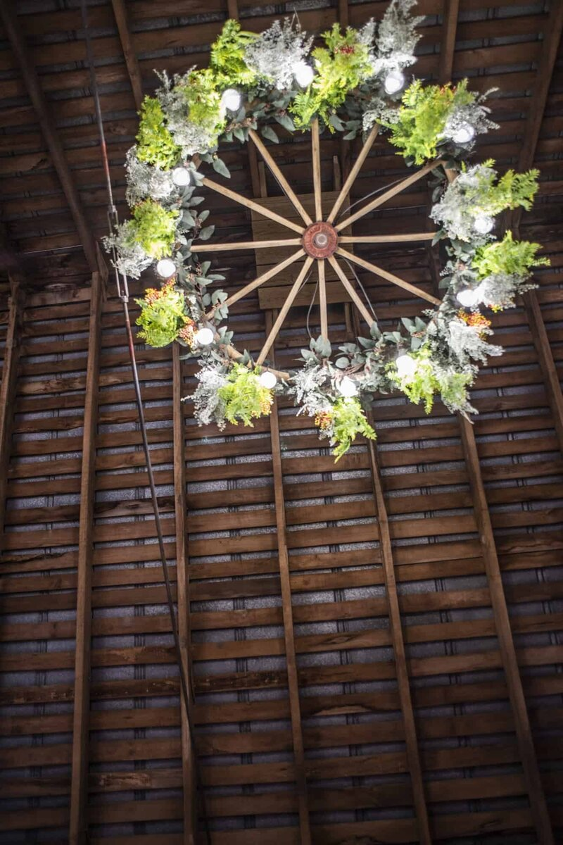 farm wedding floral wagon wheel chandelier