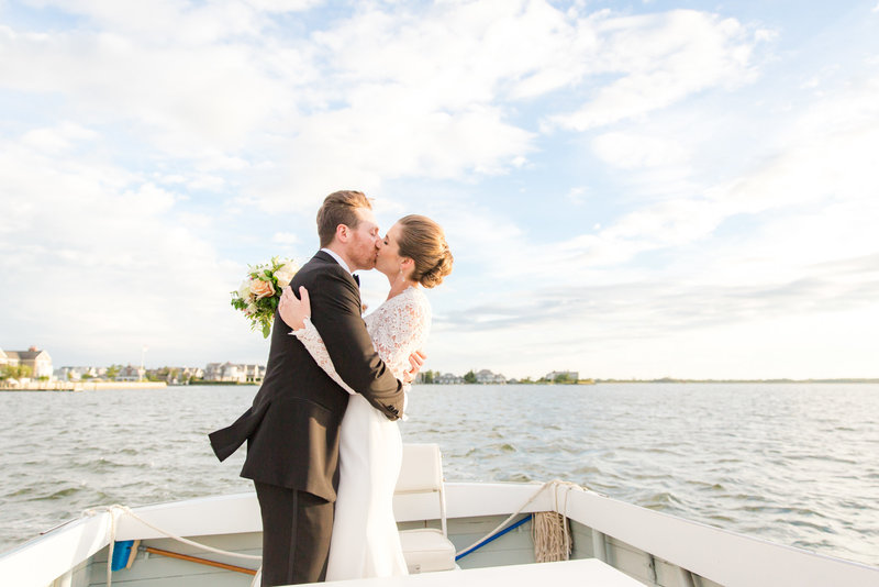 Bride and groom kissing on a boat