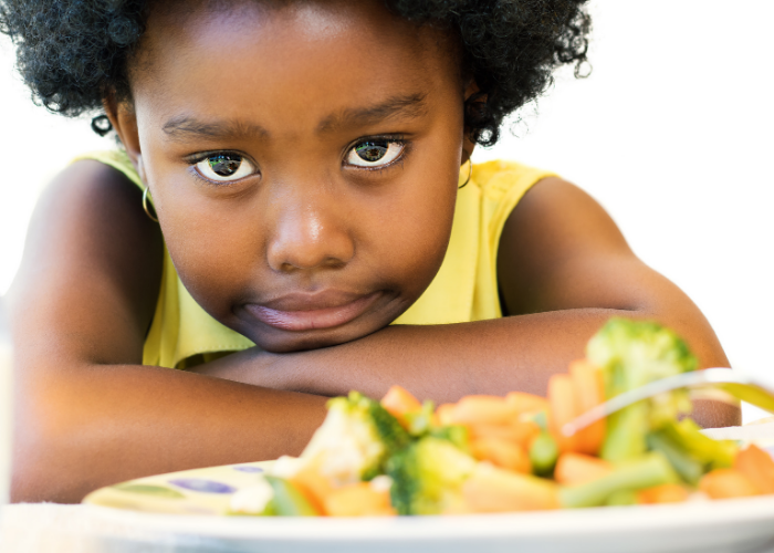 Thrive by Spectrum Pediatrics image for book titled anxious eater, anxious mealtimes practical and compassionate strategies for mealtime peace by Marsha Dunn Klein is a child with food at mealtime