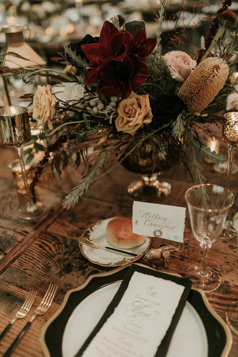 Moody reception table setting for New Years Eve wedding at the Natural History Museum in Los Angeles