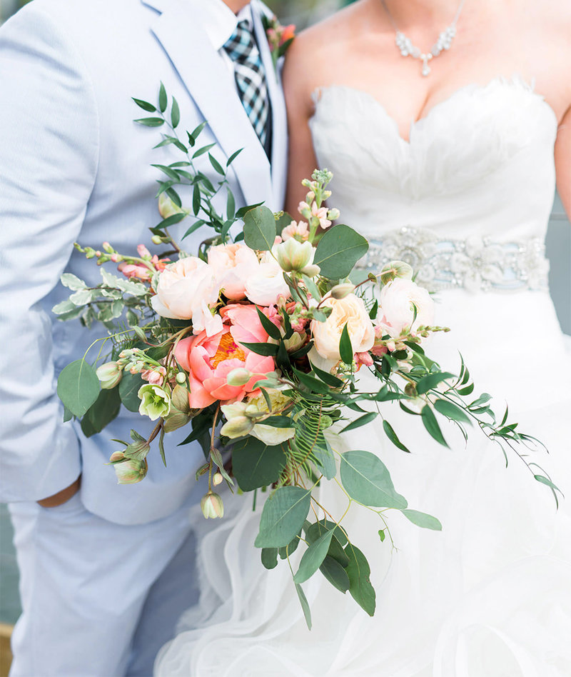 loose bridal bouquet with pink peonies, snapdragons, and eucalyptus leaves