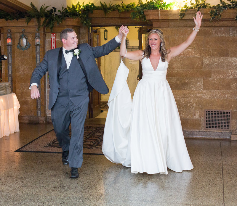 Bride and groom enter their Masonic Temple wedding reception