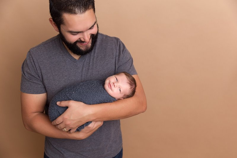 dad holding smiling baby boy