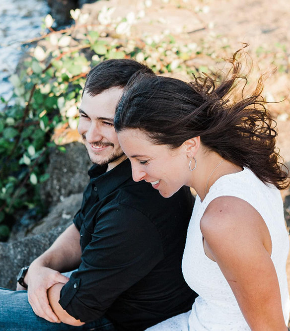 a couple spends time together next to a lake in Seattle during their summer engagement session with Amy Galbraith