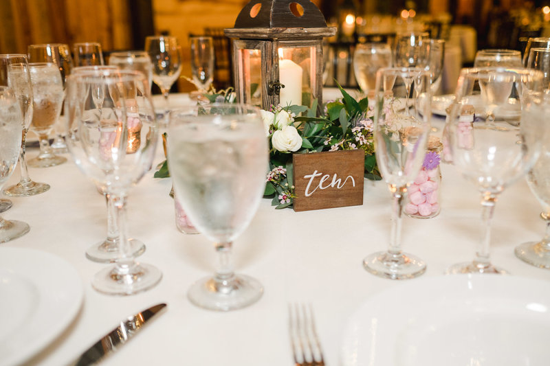 Table scape with wooden signage at Club Lake Plantation Wedding reception