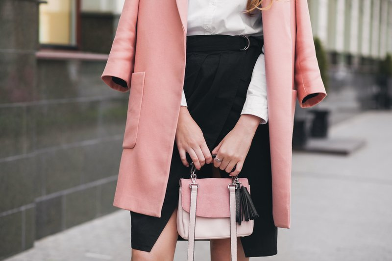 Woman in Pink Coat and Black Skirt