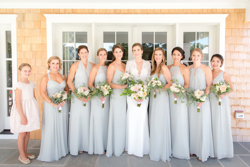 Bridesmaids in soft green dresses