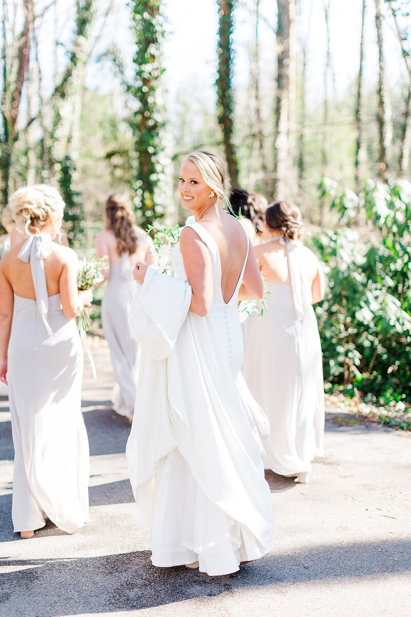 bride walking with bridesmaids by Knoxville Wedding Photographer, Amanda May Photos