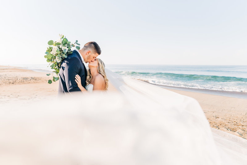 Virginia Wedding Photographer, bride and groom kissing on the beach