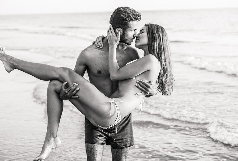 stock photo - sexy couple ocean black and white