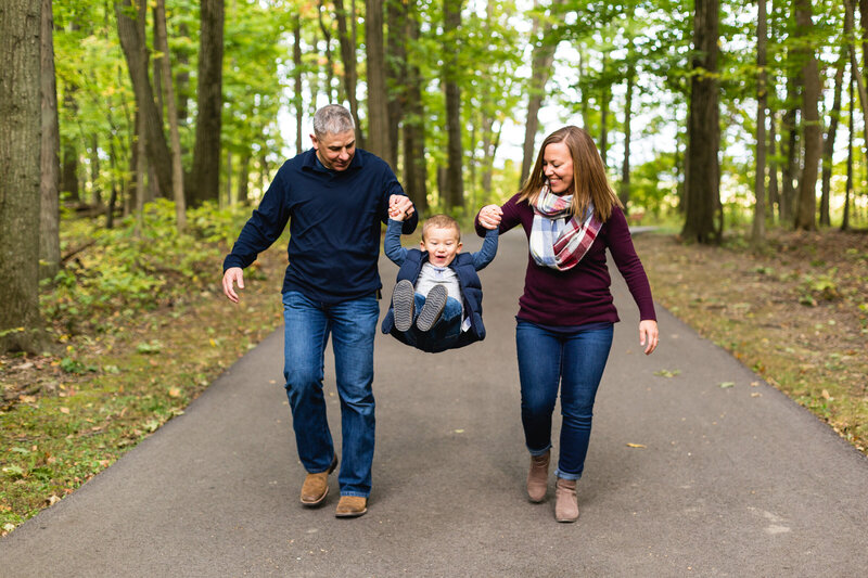 candid family portrait on trail at park in ohio