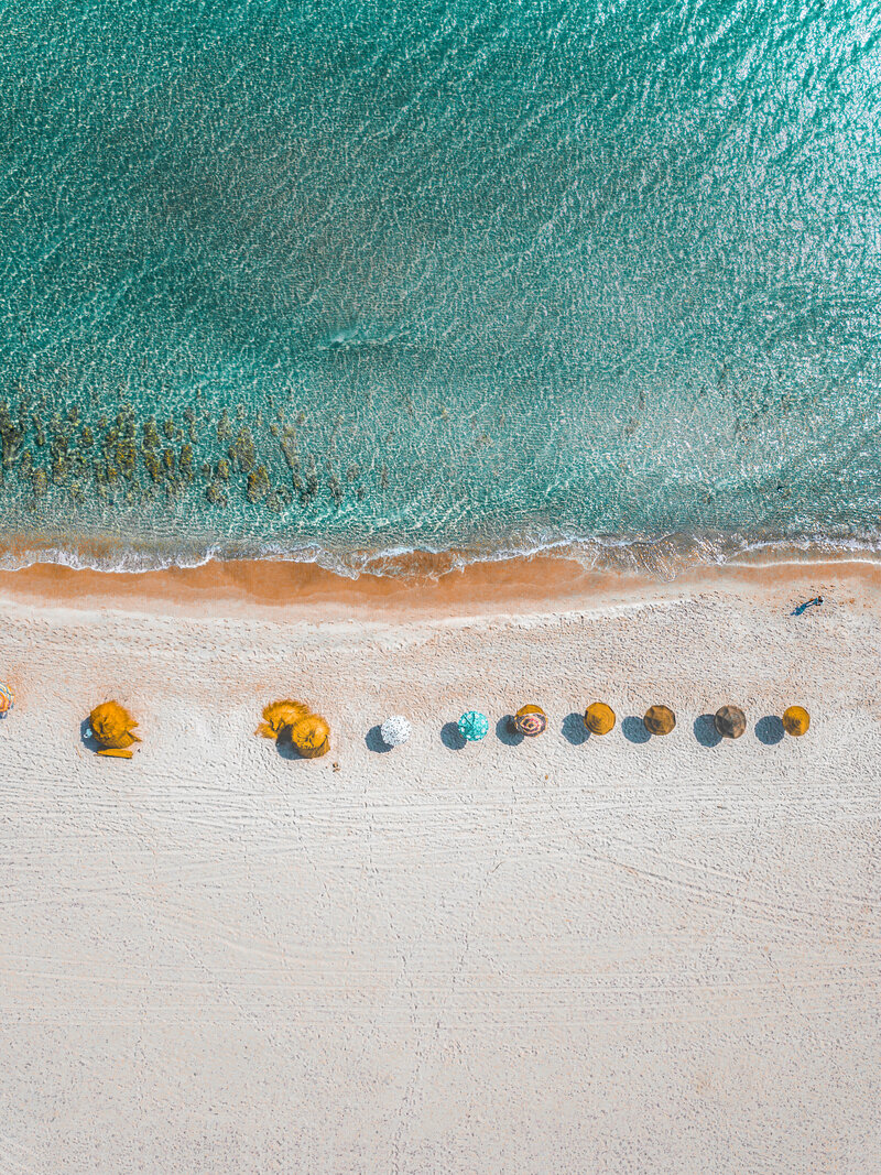 aerial-view-photography-of-umbrellas-on-shore-1710795