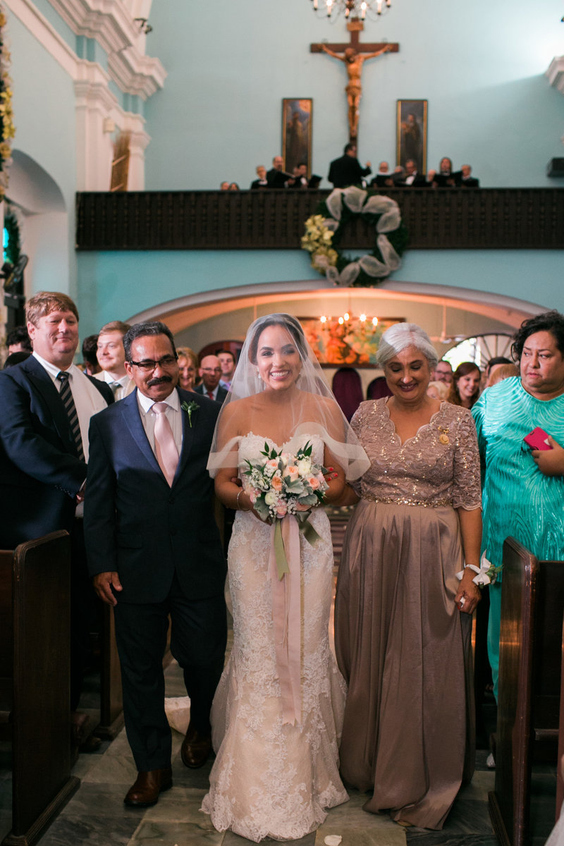 Bride walks in Parroquia San Francisco de Asis