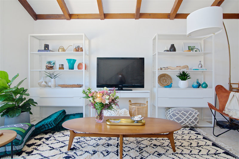 Decorative shelves in a midcentury modern and bohemian influenced living room by Denver based interior designer Fernway & Avalon