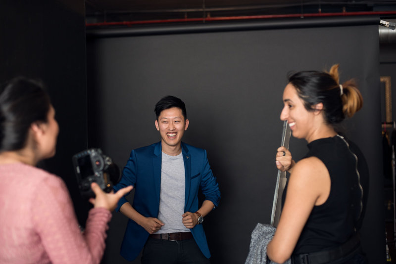 Behind the scenes portrait of David Suh being photographed at a studio