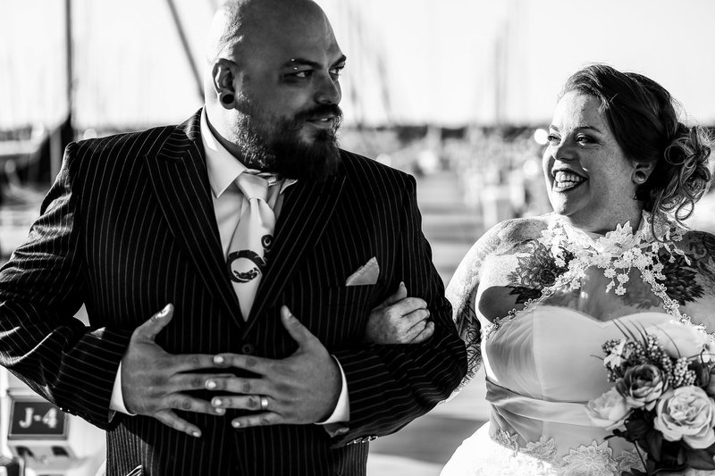 Bride smiles at her groom  at the Erie Yacht Club