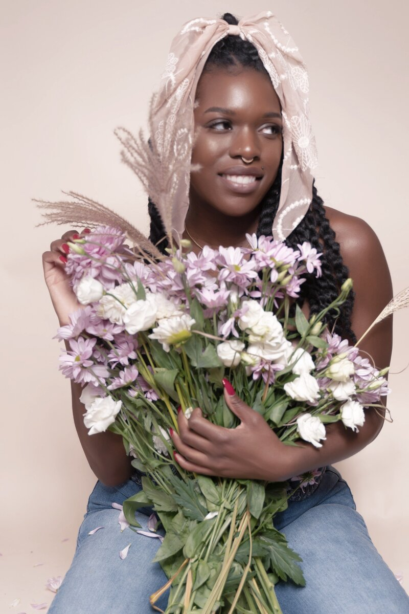 black woman holding flowers