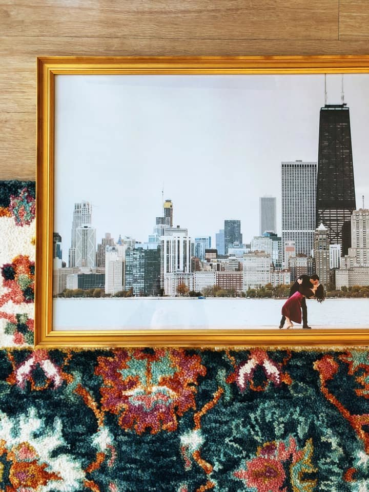 Printed photo of couple kissing in front of Chicago skyline framed in gold.