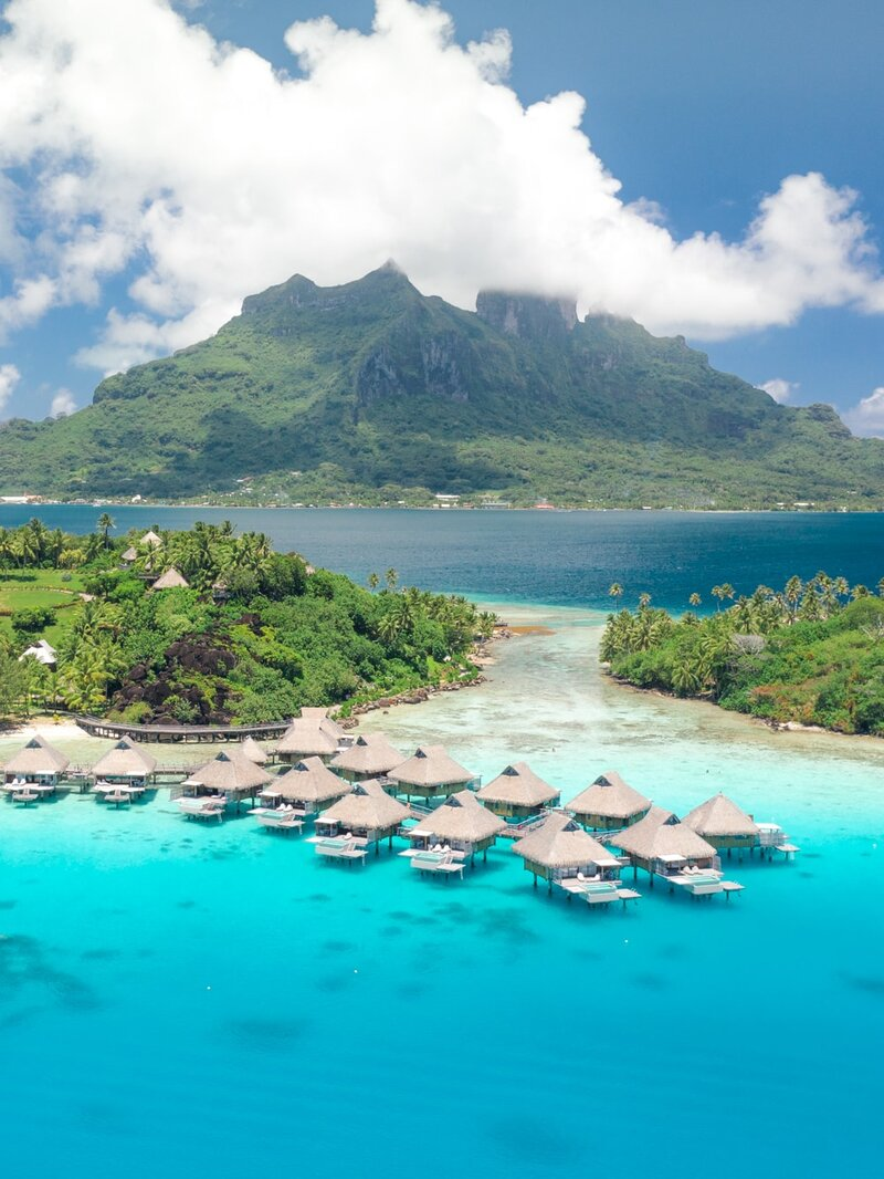 Luxury overwater bungalow in the Intercontinental Bora Bora, view on the couple and the lagoon