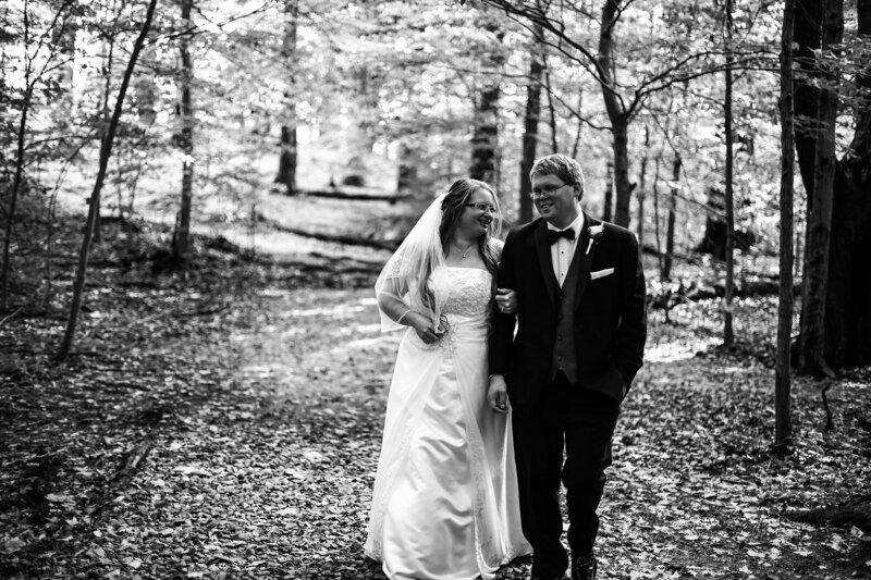 Bride and groom walking through Wintergreen Gorge in Erie, PA