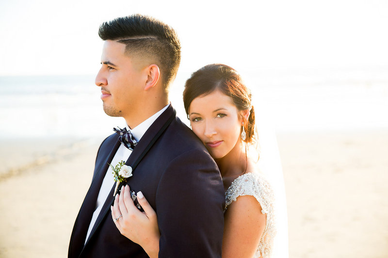 Wedding Couple Embracing at Beach  During Sunset
