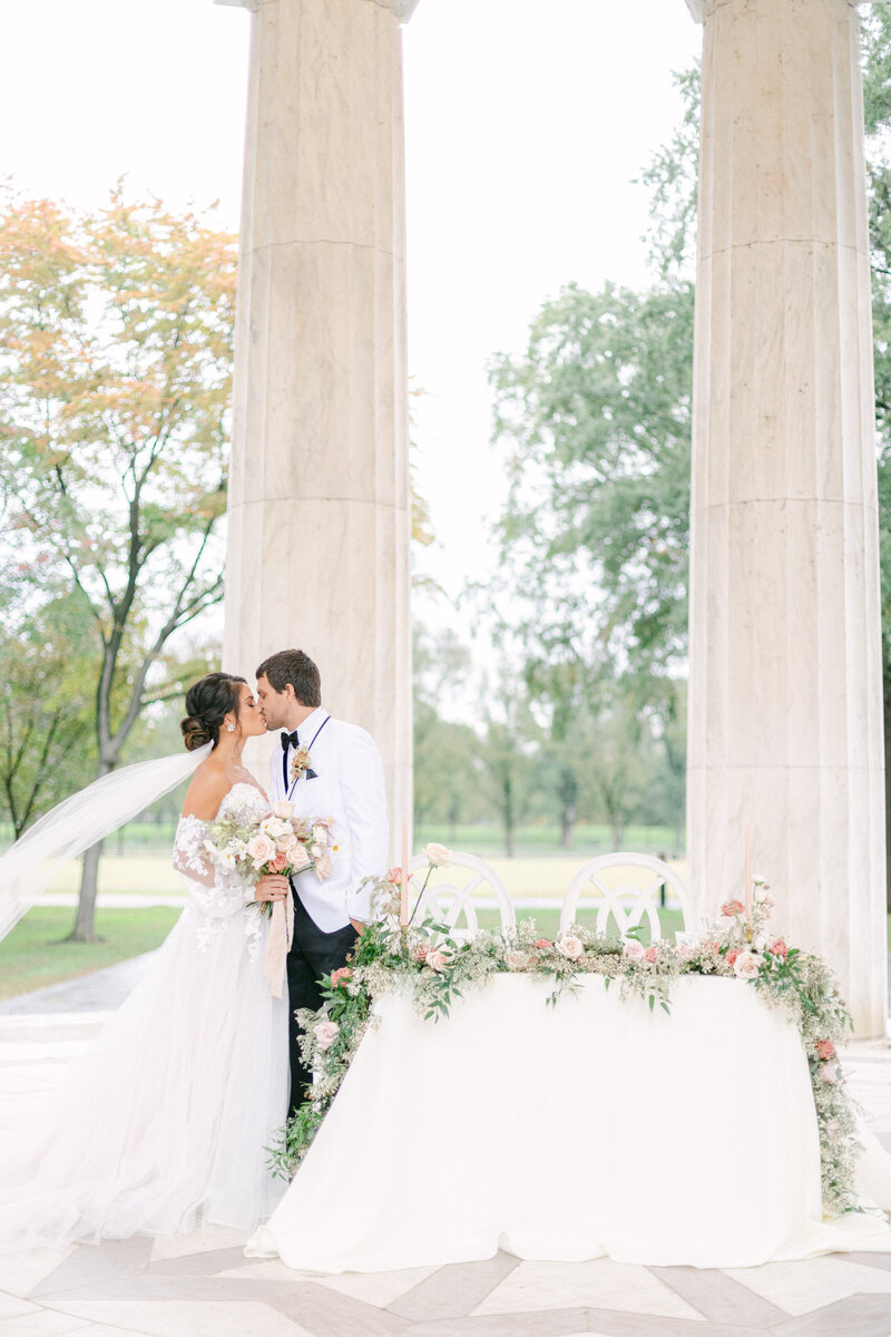 bride and groom by sweetheart table at Washington DC Romantic Classic Wedding at the Lincoln Memorial by Costola Photography