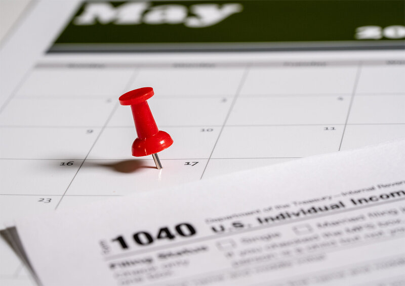Calendar with April 15th marked off for tax day