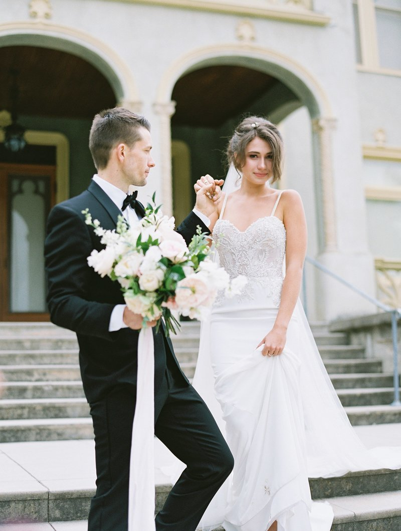 daniel-and-bethany-weddings-groom-giving-bride-hand