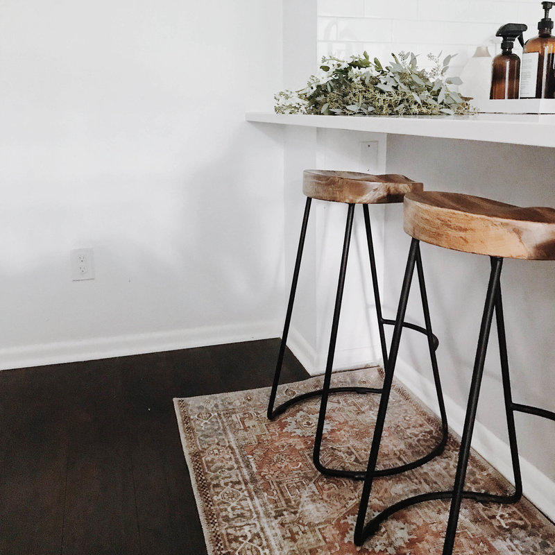 Wooden stools pulled up to kitchen countertop