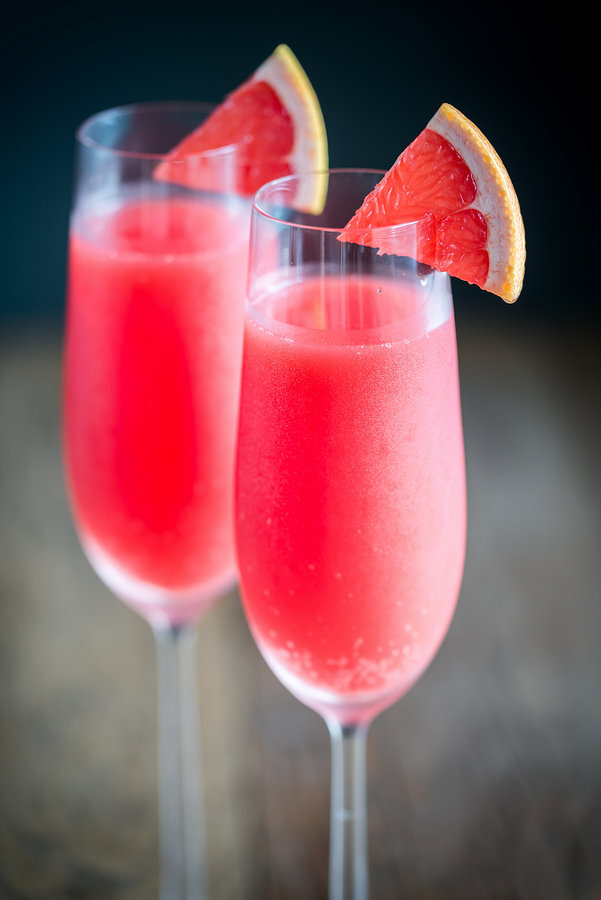 stock photo - two red pink champagne cocktails coral