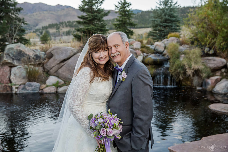 Fall-Wedding-Portrait-with-Pond-Backdrop-and-Mountains-at-Greenbriar-Inn-Restaurant