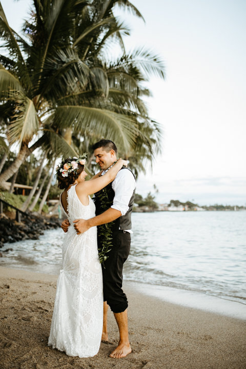 Married  couple dancing under palm trees