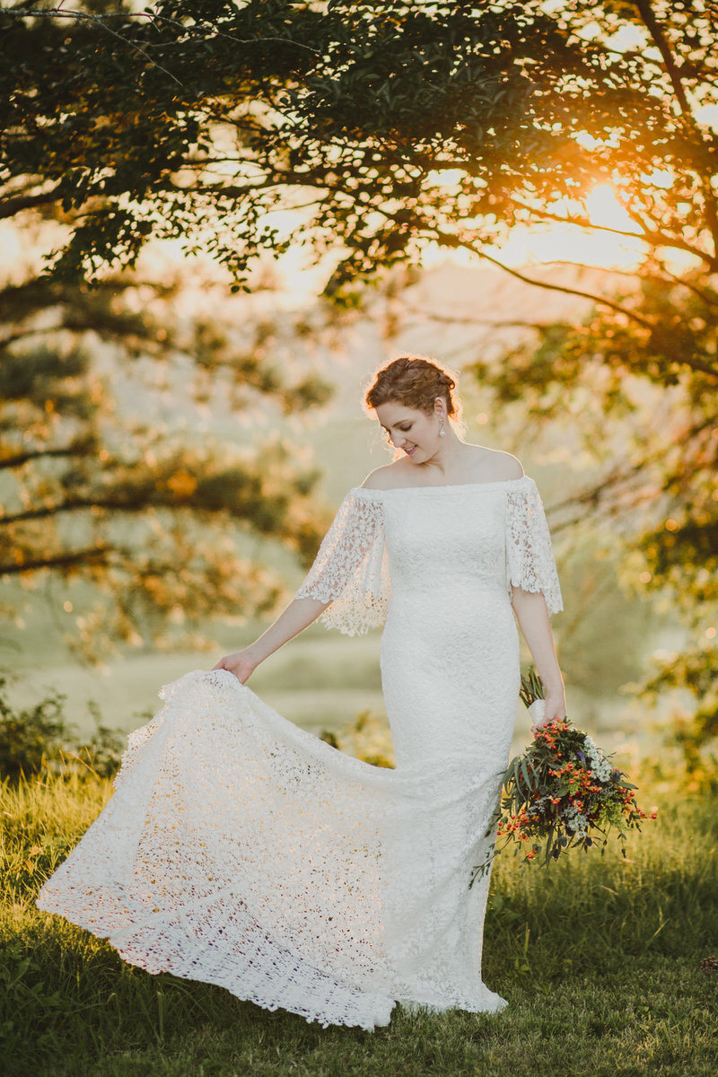 Melissa poses during her bridal photos in Spring Hill, Tennessee with the golden sunset behind her.