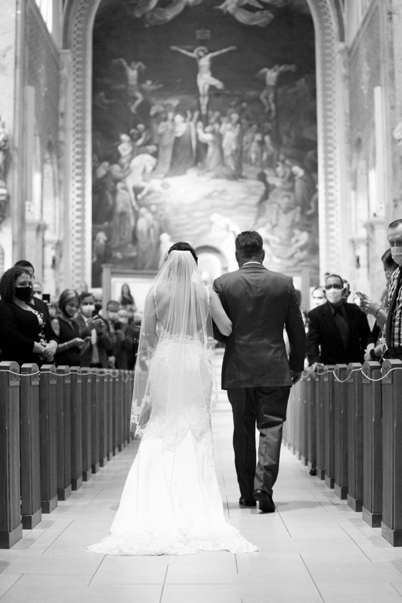 father walking bride up aisle in detroit catholic wedding