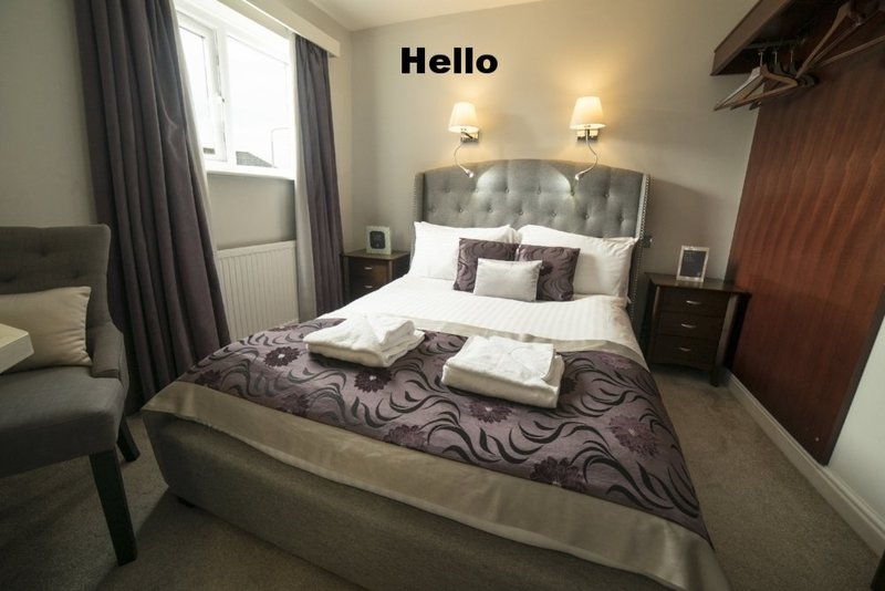 Room_103_wide_angle_bed
