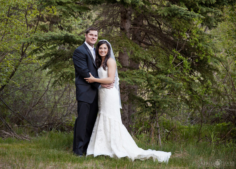 Forest portrait of a wedding couple with pine tree at Mountain View Ranch