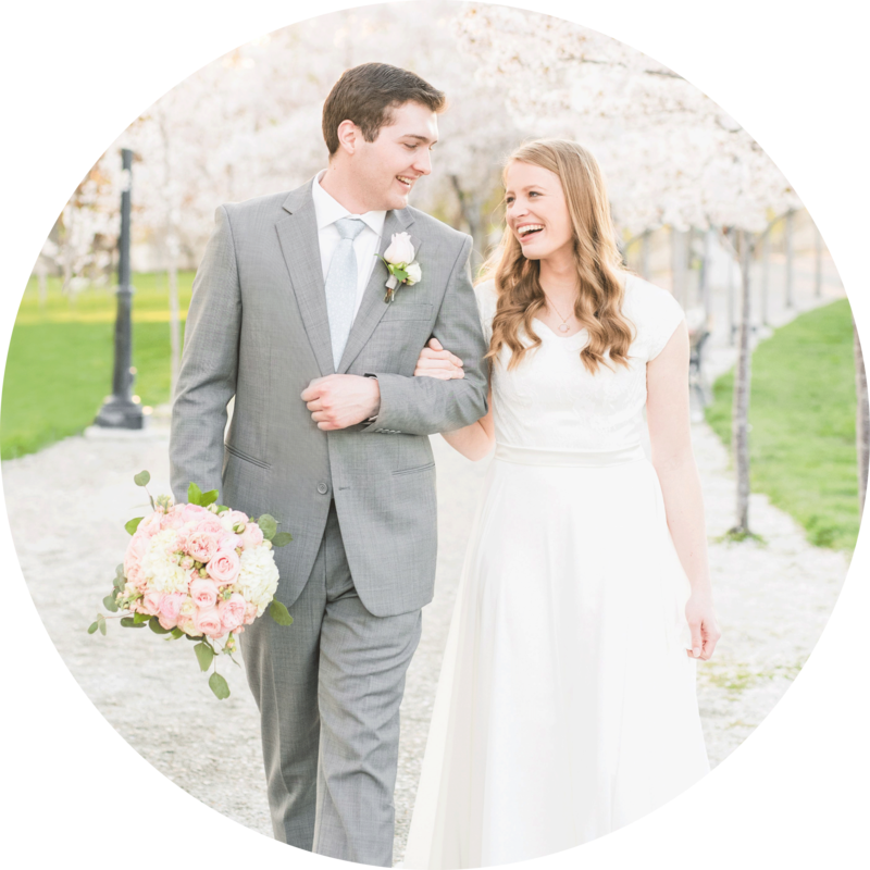 Bride and Groom walking in the blossoms at the Utah State Capitol