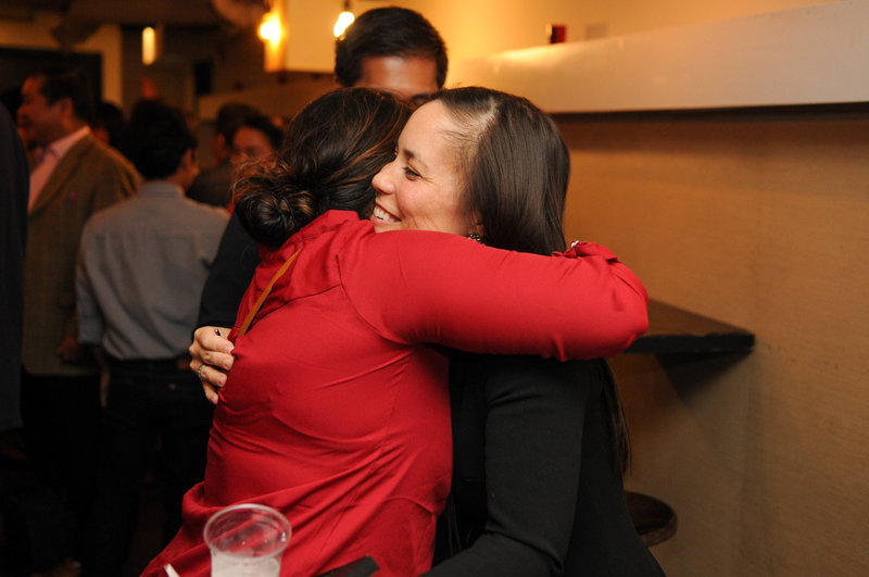 Gina Ortiz Jones Texas congressional candidate hugging voter