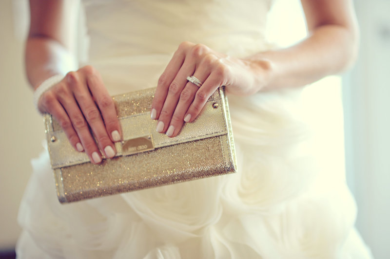 Bride holding her clutch getting ready for a Calgary wedding
