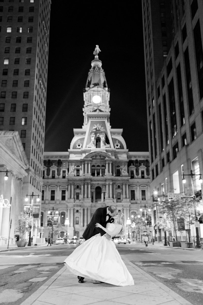 Wedding couple in front of Philadelphia City Hall at night