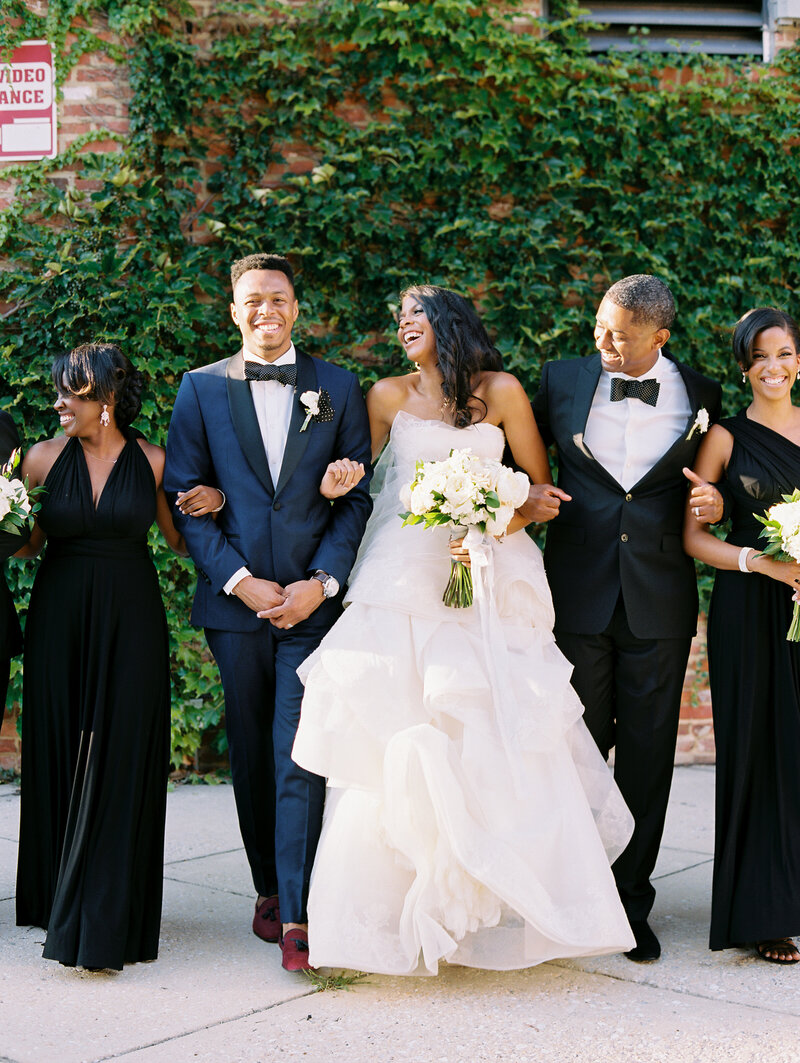 Bride and Groom walking with bridal party