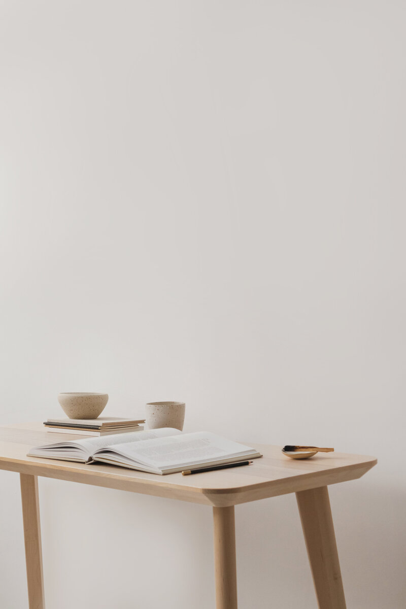 table with nook and mugs sitting on top of it